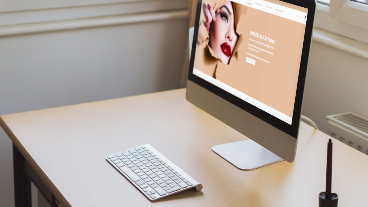 online tree imac displaying mittenbody website on screen