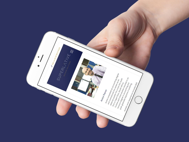 online tree iphone displaying superlative website on screen