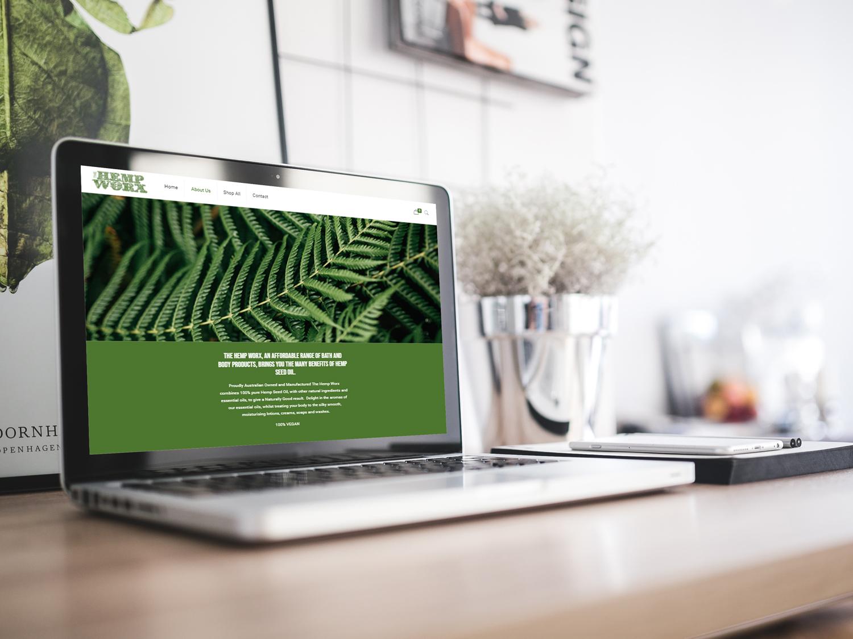 online tree laptop displaying hempworx website on screen